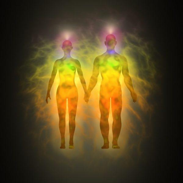 12295481 - woman and man energy body, aura, chakras, energy, silhouette