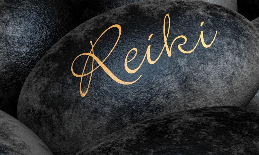 13823560 - black stones with text - reiki